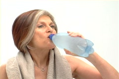 Mature female health drinking -NTSC Stock Footage