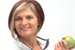 Mature healthy female with apple NTSC Stock Footage