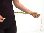 Mature female waist measure-NTSC Stock Footage