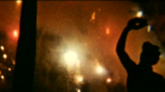 Man under fireworks bombing 01 - Vintage 8mm Film Stock Footage