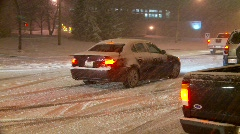 Weather, snowstorm, sliding cars and spinning tires Stock Footage