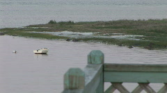 Fisherman boat over boathouse rail Stock Footage
