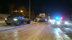 Winter snowstorm, semi truck spinning tires Stock Footage