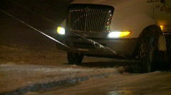 Trucking, snowstorm, tow truck and jacknifed semi, #1 Stock Footage