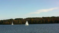 Two sailboats on a beautiful fall day Stock Footage