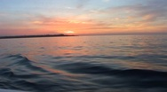 Stock Video Footage of Sunrise at sea from a moving boat