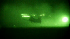 Army Helicopter lands at night (HD) m Stock Footage
