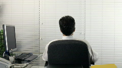 Man day dreaming at work back Stock Footage