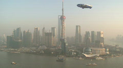 Shanghai Pudong river and Orient Pearl large view with Zeppelin passing by Stock Footage