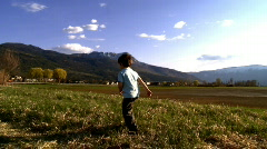 Young boy walking in nature - stock footage