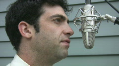 Man talks to microphone. Stock Footage