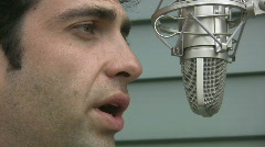 Man talks to microphone. Closeup. Stock Footage