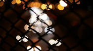 Night traffic through fence Stock Footage