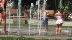 Kids Playing in Water Fountain Stock Footage