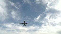 Passenger jetliner landing in airport Stock Footage