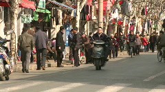 Downtown Shanghai Typical Chinese Street traffic and life  - stock footage