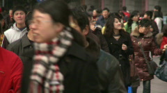 Chinese people walking in downtown Shanghai, quite crowded Stock Footage
