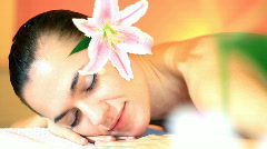 Close up of a young woman in a spa with flower  Stock Footage