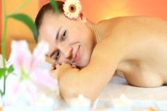 Young woman with flower lying in a spa  and smile Stock Footage