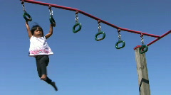 Little Girl On Playground Rings Stock Footage