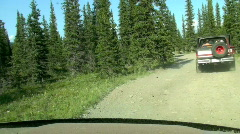 ATV Race along Rugged Dirt Road Bouncing and Swerving in Trees (time lapse) Stock Footage