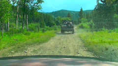 Hobby 4x4 Trucks Driving off Road in bright Sunny Daylight Stock Footage