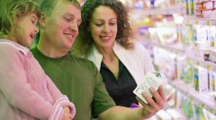 Smiling family buying yogurt in supermarket Stock Footage