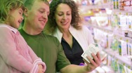 Stock Video Footage of smiling family buying yogurt in supermarket