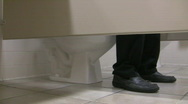 Man sitting on toilet  with pants down Stock Footage