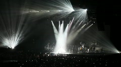 people in concert hall look at singer stand at scene in light of beams - stock footage