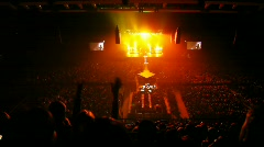 Singers appear on scene filled in with gold light in concert hall Stock Footage