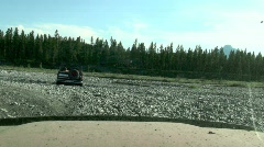 Toyota 4x4 follows Ford Bronco over Boulder Field into Dry Creek Channel Stock Footage