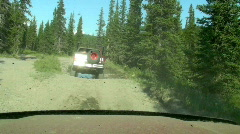 Two 4x4 Pickup Trucks Drive in Big Puddle Splashing Mud Spray Stock Footage