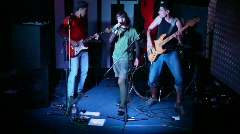 Musical group of four persons live on stage in night club Stock Footage