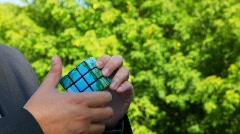 Unidentified man solves brainteaser earth globe Stock Footage