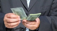 Unidentified man counting dollars Stock Footage