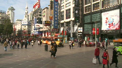 Chinese people walking around downtown Shanghai, Nanjing road Stock Footage