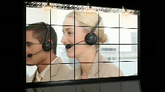 People working in a call centre - stock footage