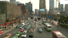Cars and Buses Traffic in Downtown Shanghai, large shot Stock Footage