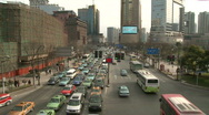 Stock Video Footage of Cars and Buses Traffic in Downtown Shanghai, large shot