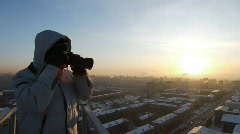 Photographer on the roof 005 Stock Footage