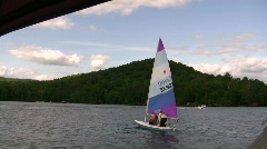 Small sail boat on lake Stock Footage