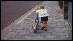 Boy rides two-wheeler (Vintage 8 mm amateur film) Stock Footage