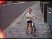 Boy with two-wheeler (Vintage 8 mm amateur film) Stock Footage