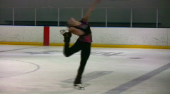 Figure skater catch foot spin Stock Footage