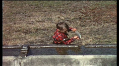 Boy playing in water tank (vintage 8 mm amateur film) Stock Footage