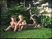 Stock Video Footage of Little brothers sitting in garden (vintage 8 mm amateur film)