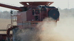 Combine Harvester Cutting Soy Crop In A Dusty Field Late Autumn Soya Beans - stock footage