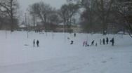 Winter snowfall park pan Stock Footage