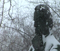 Statues in Park during Heavy snowfall - Pan Stock Footage